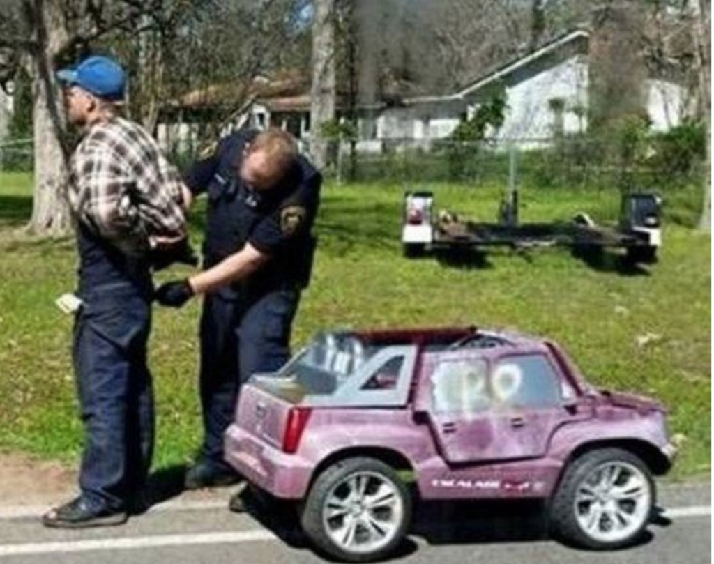 Man Pulled Over by Police while Driving a TOY CAR