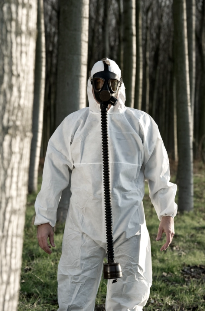 Man wearing hazard suit while doing an investigation on the mystery smell around the county
