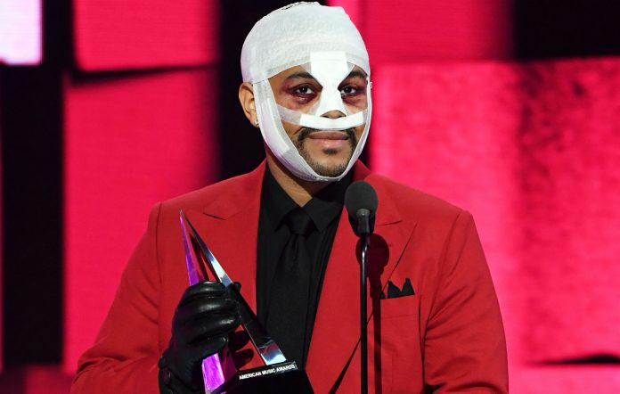 THE WEEKND Can't Feel His Face Full of Bandages as He Accepts Award at the AMAs