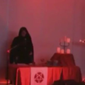 devil worshipers with cross upside down